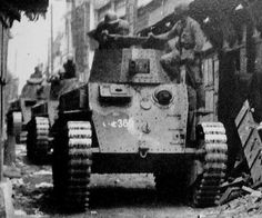 Three Type 89 tanks rolling down a street during the invasion of provinces inside China