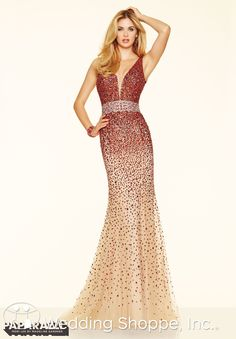 A sexy beaded prom dress with plunging neckline. Also available in turquoise.