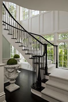 white black staircase - I LOVE this SPACE! It is all perfect! the spheres in the urns are piece de resistance...