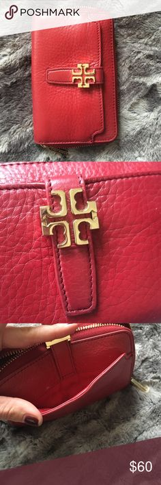 Tory Burch cherry red leather phone wallet Photos taken in natural light with NO filters. I purchased this on posh recently but didn't realize how red it was so it doesn't match what I bought it for. My loss is your gain! It's about 4x6, interior pockets, exterior pocket. Missing the wrist strap as shown in photo. Good condition, some minor signs of wear that's hard to see due to depth of the color. Tory Burch Bags Wallets