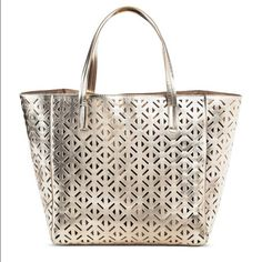 Women's Perforated Tote Handbag. Light Gold Stow your on-the-go essentials in style with this Women's Perforated Tote Handbag. Lightweight enough for everyday but spacious enough for a weekend away or a great pool/beach bag, this versatile bag is sure to be your next go-to. Polyurethane construction is durable yet lightweight. Spacious interior easily stows your must-haves, interior has s few light stains. Magnetic closure keeps your stuff secure. This bag was used for one week on vacation…