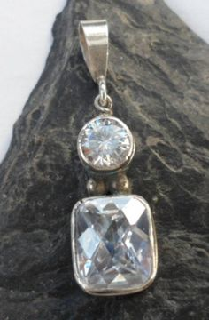 $34.00~Sterling Silver Drop Pendant with Two Faceted White Topaz Gemstones~Designed in Bali~for more details on this pendant please click on the picture.