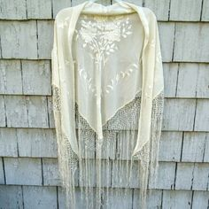 "Vintage Embroidered Silk Shawl with Fringe This is a stunning, floral embroidered, off white, silk shawl with long fringe and is in great, vintage condition! Fabulous for a summer wedding, to complete that perfect boho style outfit, or even fabulous on a table top as decor! 72"" across top (excluding fringe) and is 29"" long (center of  hypotenuse to bottom corner of triangle, the part worn down the backside). Vintage Accessories Scarves & Wraps"