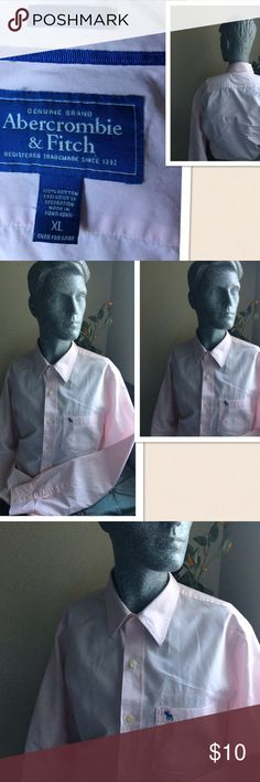 """Abercrombie & Fitch Muscle Button Down Shirt Abercrombie & Fitch Muscle Button Down Shirt. Size: XL. Pit-pit: 22.5"""" Length: 29"""". Shoulder : 6"""", sleeve from arm pit- cuff: 23"""". Color: Pink & Blue. Gently washed and worn with ❤. Excellent condition. Abercrombie & Fitch Shirts Casual Button Down Shirts"""