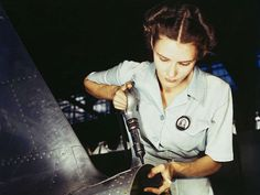 Rare color photos: Women at work in the 1940s Answering the nation's need for woman power, Mrs. Virginia Davis made arrangement for the care of her two children during the day and joined her husband at work in the Naval Air Base, Corpus Christi, Texas.