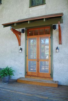 Arts & Crafts custom door and bracket overhang, maybe this would help ...