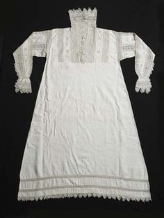 A woman's white linen smock decorated with intricate bands of geometric cutwork taken from another object, possibly a cover, and used as ins...