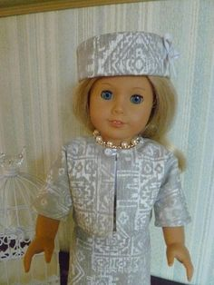This one-of-a kind 1960s outfit includes: a slim sleeveless sheath dress, box jacket, pillbox hat and faux pearl & rhinestone necklace. It is modeled on an American Girl doll and will fit other 18 dolls with a similar body type -- such as the Madame Alexander 18 doll. Please read