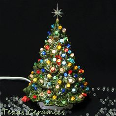 This made to order ceramic Christmas Tree is a Shenandoah Pine lighted tabletop style tree that is loaded with lots of colorful lights. This tree has well over 140 jewel color globe ornament lights. Ceramic Christmas Trees, Mini Christmas Tree, Christmas Time, Vintage Christmas, Christmas Bulbs, Holiday Gifts, Holiday Decor, Holiday Ideas, Globe Ornament