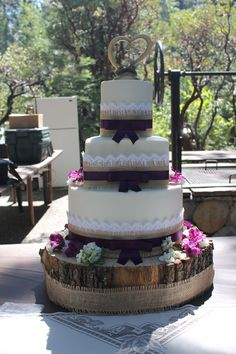 Full view of Country Inspired Wedding cake on wood slab base. Burlap, lace, and ribbon.