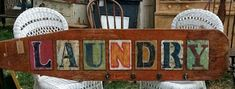 The Junk Chick ~ Old ironing board turned Laundry Sign