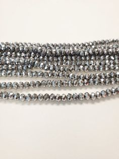 100 Silver Metallic 3x4mm faceted glass beads, Suncatcher Beads, Spacer Bead, rondelle beads, R20 by vickysjewelrysupply. Explore more products on http://vickysjewelrysupply.etsy.com