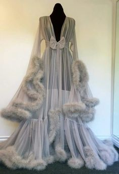 Marabou dressing gown, in dove grey, by Catherine D'Lish. Ooooh, imagine floating around your luxury apartment, sipping fine French champagne, and wearing this