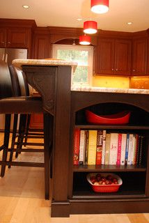 kitchen island in espresso wood doubles as cookbook bookcase in Bryn Mawr Kitchen designed by www.down2earthdesign.com
