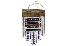 """""""This beaded apron by the Ndebele is called jocolo. Jocolo is distinguished by five panels on the lower section. Such aprons are worn by the bride on their wedding day. A complete bridal costume includes a beaded headband, beaded front wedding veil, a beaded blanket (orare), the bridal cloak and a beaded bridal stick."""""""