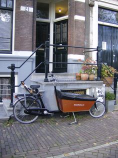 There are thousand of bikes in Amsterdam but the Bakfiets are truly dutch. #NL #travel #bikes @Patricia Smith Nickens Derryberry Holland