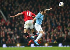 Alvaro Negredo Photos Photos - Alvaro Negredo of Manchester City competes with Michael Carrick of Manchester United during the Barclays Premier League match between Manchester United and Manchester City at Old Trafford on March 25, 2014 in Manchester, England. - Manchester United v Manchester City