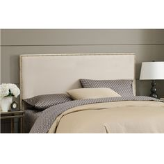 This full-size oatmeal headboard will add elegance and sophistication to any bedroom. With its solid hardwood, oatmeal finish, soft microsuede upholstery, and nailhead trim, this full-size headboard is sturdy and aesthetically pleasing.