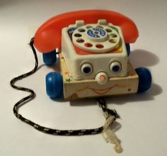 telephone. Every little one had this toy. Do they even make these rotary dial pull toy phones?