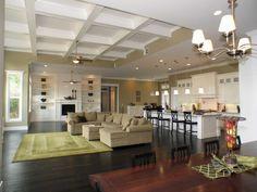 Love the open floor plan, dark floors, & kitchen layout.