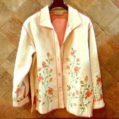 Cream Canvas Jacket with Floral Embroidery So pretty! Heavy canvas coat is lined and has abalone shell buttons. All edges are zig zag stitched with coral colored thread. Floral design on front, back, and sleeves. Monterey Bay Clothing Company Jackets & Coats