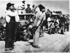 Pickets on the highway calling workers from the fields, 1933 cotton strike. International News Photos, Inc.  UC Berkeley, Bancroft Library 1945.007:6