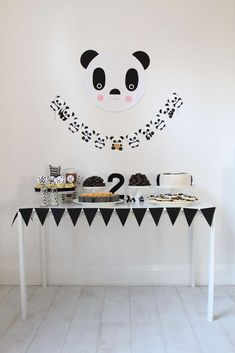 Black and white dessert table at a panda birthday party! See more party planning ideas at CatchMyParty.com!