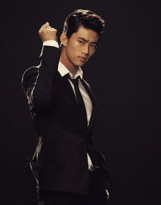 Taecyeon - OMG, THAT is a suit....  Love the loose tie and open button..