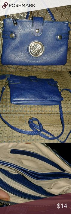 """Small Navy Crossbody Navy bag with zips shut to conceal 3 compartments. One with slip pocket, zippered pocket and center has 3 card slots. Sides unsnap  to extend. Appx 5.5x8.5 with 48"""" adjustable removable strap. Only flaw found is a small chip see pic 7. EUC. Bags Crossbody Bags"""