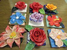 """Ceramic flower sculptures by 4th graders; approx. 7"""" X 7""""; art teacher: Susan Joe"""
