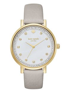showcasing a beautiful clocktower grey leather strap against a luminous mother-of-pearl dial with crystal indexes and topring, this timeless kate spade new york watch will turn even the most everyday