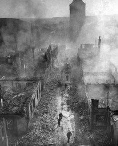 GERMAN RUINS, 1945. U.S. infantrymen move down a street in Waldenburg, Germany, after a raid during World War II, April 1945.