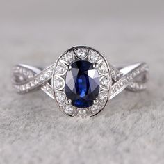 5x7mm Oval Cut Blue Sapphire and Diamond Engagement Ring 14K White Gold Halo Twist Loop Infinity