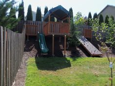 Backyard hillside rock wall, slide and play area, sloped yard                                                                                                                                                                                 More