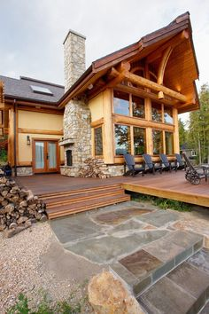 Traditional home exterior contemporary with wood deck log home