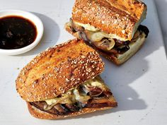 These Plant-Based Mushroom French Dip Sandwiches Have 365 Calories | A sandwich-shop classic, the French dip—a beef-loaded baguette-and-jus combo—delivers a whopping 1,400mg sodium (more than 60% of your daily recommended limit) plus almost 9g sat fat. To create a healthier handheld without forfeiting its meaty character, we use toothsome mushrooms to mimic meat's heft and enrich the sandwich with noteworthy umami. Caramelized onions get layered on for the perfect alchemy of sweetness and…