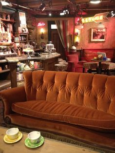 Central Perk's famous sofa that inspired an entire generation of coffee drinkers.
