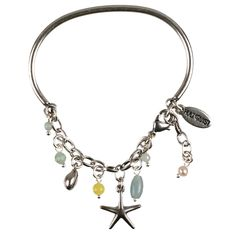 The feel of a world under the waves, combining starfish, cowry shells & fresh water pearls