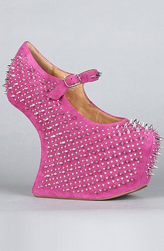 Jeffrey Campbell:  The Prickly Shoe in Fuchsia Suede.  These are so ....  ummm ... different.