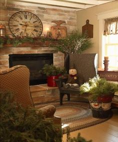 Primitive Country Christmas...love the clock over the mantel, painted snowman bucket  the prim snowman on the chair.