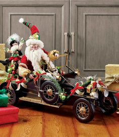 St. Nick is ever quick behind the wheel of this classic car, which stretches more than 2-1/2 feet. The elf can be posed on the car in many fun ways.