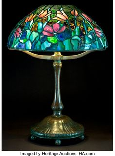 A Tiffany Studios Patinated Bronze Lamp With Tulip Glass shade. Tiffany Studios, Corona, New York, circa 1900 Tiffany Stained Glass, Stained Glass Lamps, Tiffany Glass, Leaded Glass, Mosaic Glass, Glass Art, Louis Comfort Tiffany, Art Nouveau, Antique Lamps