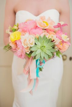 colorful bouquet featuring poppies, ranunculus, roses, peonies and succulents by Sullivan Owen