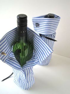 wine bottle wrapping made from old shirt sleeves -- sew up the bottom, do up the cuff and add a ribbon around the neck for extra hold. <3