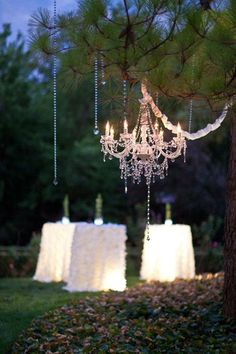 underlit tables chandelier crystals and ruffled table linens