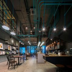 A Modern Cafe and Maker's Space in Thailand - http://freshome.com/cafe-and-makers-space-in-thailand/