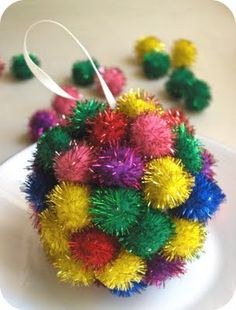 Twinkle Pom Pom Ornament from Zakka Life - an ornament craft kids and parents can make together.