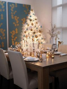 Blue and gold holiday dining with glam white tree
