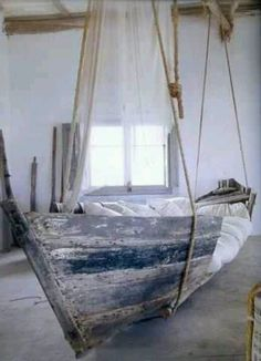 A lovely idea for a beach cabin. Reuse an old boat as a bed or couch.