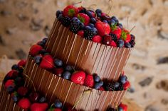 A beautiful layered choclate cake topped with fresh Suffolk grown berries - From Crumb.
